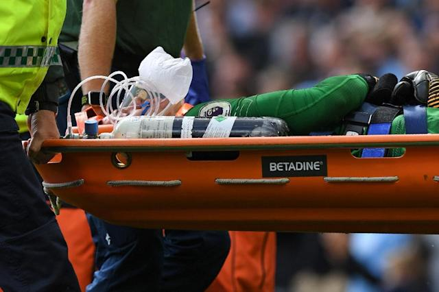 Manchester City's goalkeeper Ederson was carried off on a stretcher during the 5-0 victory over Liverpool at Eastlands (AFP Photo/Paul ELLIS)