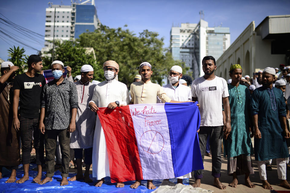 Supporters of several Islamist parties protest after Friday prayers in Dhaka, Bangladesh, Friday, Oct. 30, 2020. Thousands of Muslims and activists marched through streets and rallied across Bangladesh's capital on Friday against the French president's support of secular laws that deem caricatures of the Prophet Muhammad as protected under freedom of speech. (AP Photo/Mahmud Hossain Opu)