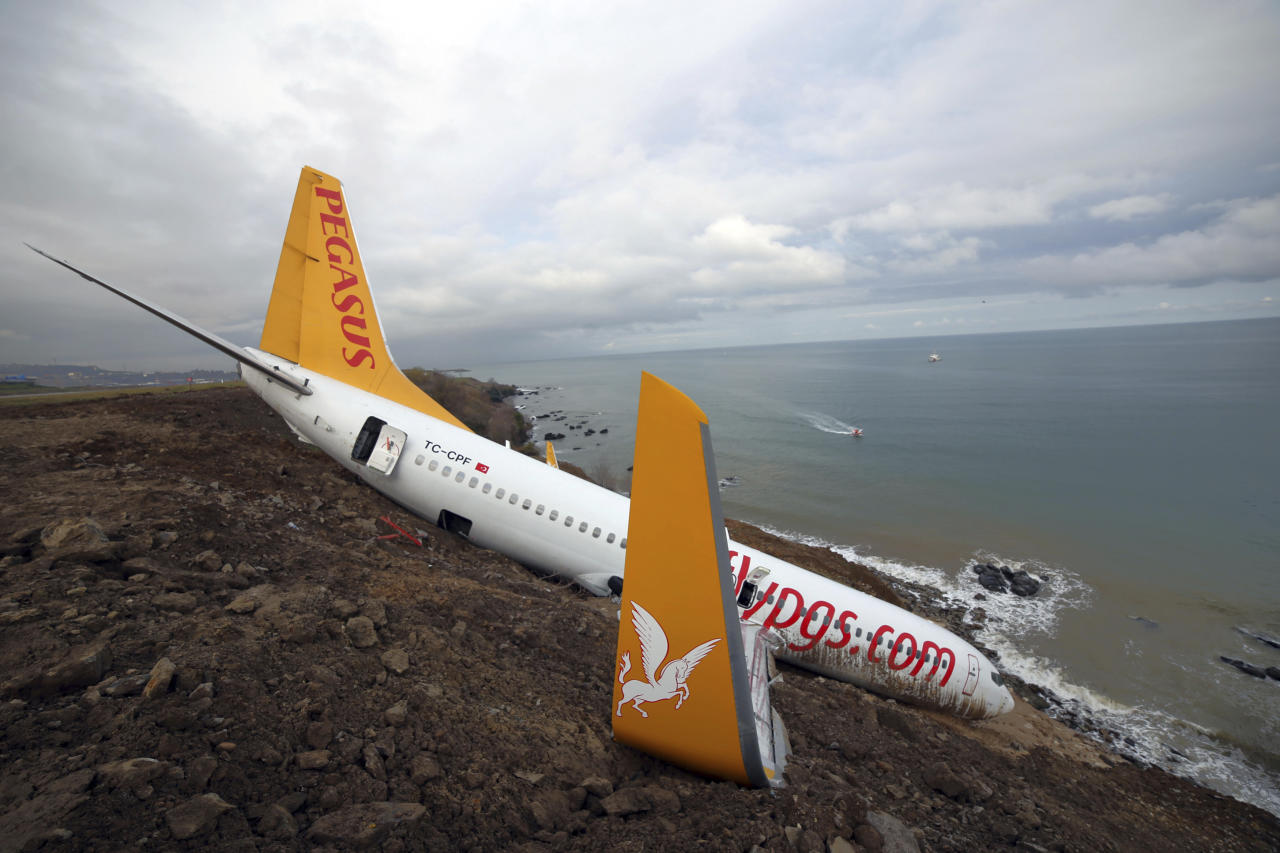 "<p>A Boeing 737-800 of Turkey's Pegasus Airlines is seen in Trabzon, Turkey, Monday, Jan. 15, 2018. A commercial airplane that skidded off a runway after landing in northern Turkey dangled precariously Sunday off a muddy cliff with its nose only a few feet from the Black Sea.Some of the 168 people on board the Boeing 737-800 described it as a ""miracle"" that everyone was evacuated safely from the plane, which went off a runway at Trabzon Airport. (Photo: DHA-Depo Photos via AP) </p>"