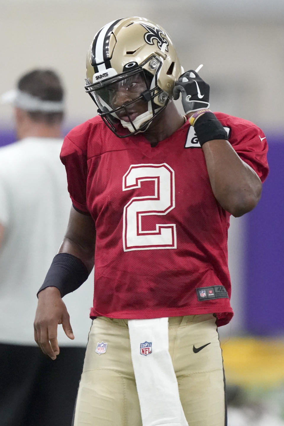 New Orleans Saints quarterback Jameis Winston (2) adjusts his helmet during NFL football practice in Fort Worth, Texas, Wednesday, Sept. 15, 2021. (AP Photo/LM Otero)