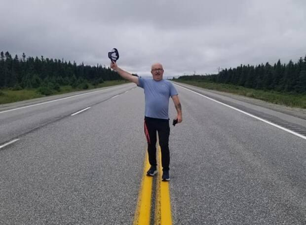 Bill Guiney of Renews is walking across the island to support mental health initiatives in Newfoundland and Labrador. (Submitted by Nicole Button - image credit)