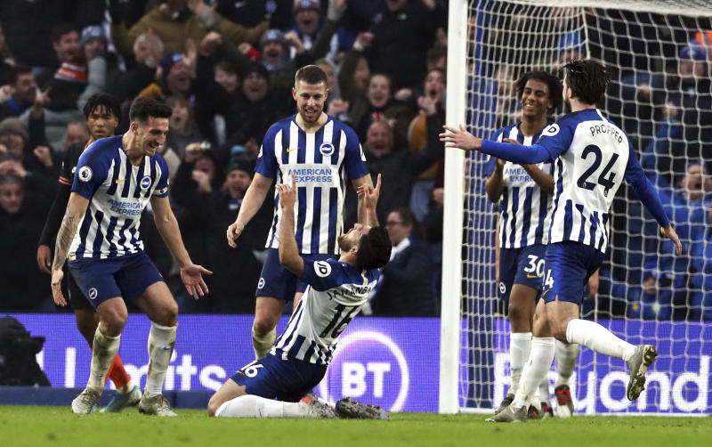 Brighton's Alireza Jahanbakhsh, centre, celebrates scoring his side's first goal of the game, during the English Premier League soccer match between Brighton and Chelsea at the AMEX Stadium, Brighton, England, Wednesday Jan. 1, 2020. (Gareth Fuller/PA via AP)
