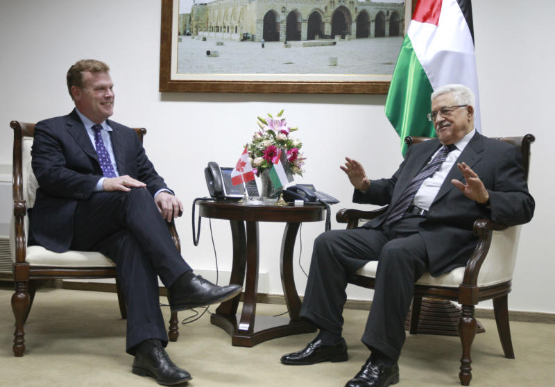Palestinian President Mahmoud Abbas, right,  speaks with Canada's foreign minister John Baird during their meeting in the West Bank city of Ramallah, Monday, June 17, 2013. (AP Photo/Majdi Mohammed)