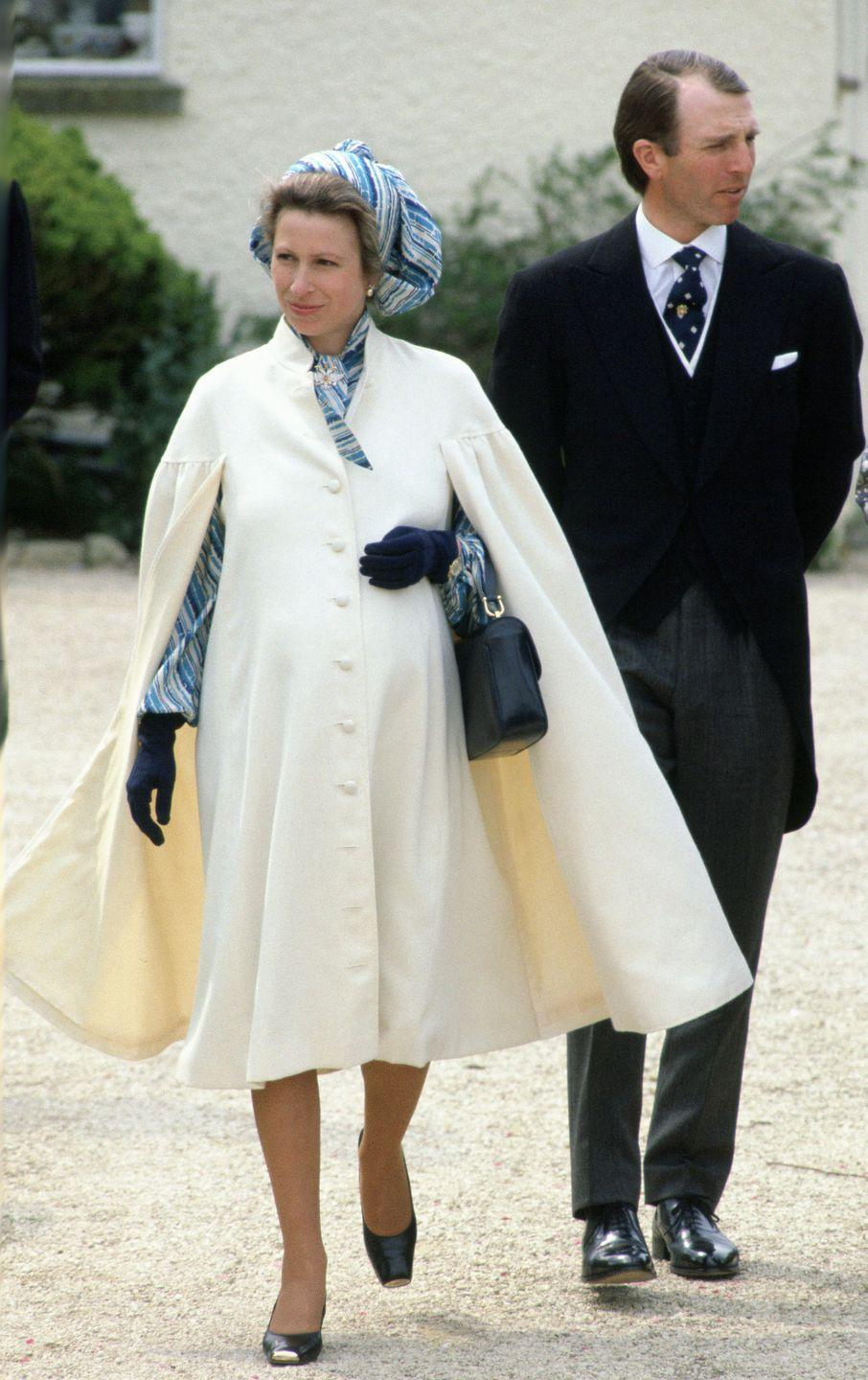 <p>Princess Anne also took the trusty coat and dress pairing into a more dramatic direction as well during her second pregnancy. Here, she wears a flowing cream-hued cape with a bold patterned dress during an outing in her ninth month of pregnancy. </p>