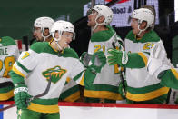 Minnesota Wild center Nico Sturm (7) is congratulated by defenseman Jonas Brodin (25) after scoring against the Los Angeles Kings in the first period during an NHL hockey game, Saturday, Feb. 27, 2021, in St. Paul, Minn. (AP Photo/Andy Clayton-King)