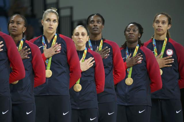 2016 Rio Olympics - Basketball - Final - Women's Gold Medal Game USA v Spain - Carioca Arena 1 - Rio de Janeiro, Brazil - 20/8/2016. Tamika Catchings (USA) of USA, Elena Delle Donne (USA) of USA, Diana Taurasi (USA) of USA, Sylvia Fowles (USA) of USA, Tina Charles (USA) of USA and Brittney Griner (USA) of USA (L to R) stand for the playing of the U.S. National Anthem during the medal presentation ceremony for the women's basketball top finishers. REUTERS/Shannon Stapleton FOR EDITORIAL USE ONLY. NOT FOR SALE FOR MARKETING OR ADVERTISING CAMPAIGNS.