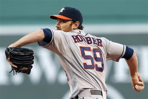 Houston Astros' Philip Humber pitches in the first inning of a baseball game against the Boston Red Sox in Boston, Thursday, April 25, 2013. (AP Photo/Michael Dwyer)