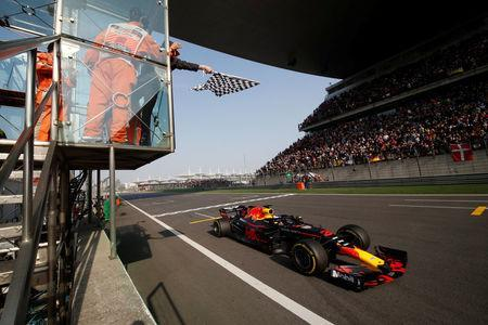 Formula One - F1 - Chinese Grand Prix - Shanghai, China - April 15, 2018 - Red Bull driver Daniel Ricciardo of Australia crosses the checkered flag to win the race. Pool via REUTERS