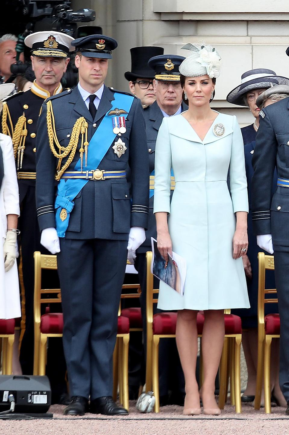 <p>To celebrate 100 years of the RAF on July 10, the Duchess of Cambridge wore an icy blue Alexander McQueen dress and a co-ordinating hat by Sean Barrett. <em>[Photo: Getty]</em> </p>