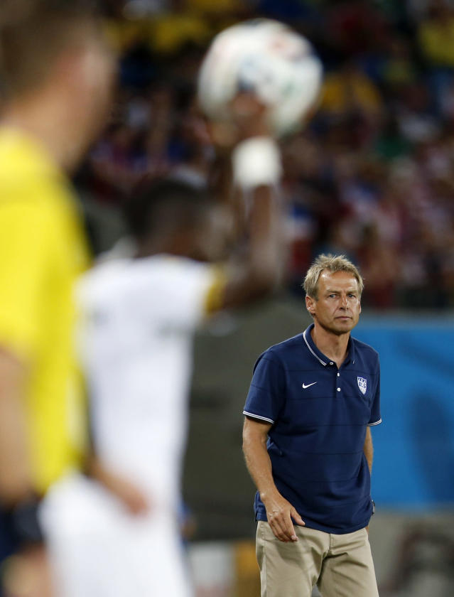 United States' head coach Juergen Klinsmann watches as Ghana player throws the ball into play during the group G World Cup soccer match between Ghana and the United States at the Arena das Dunas in Natal, Brazil, Monday, June 16, 2014. (AP Photo/Julio Cortez)