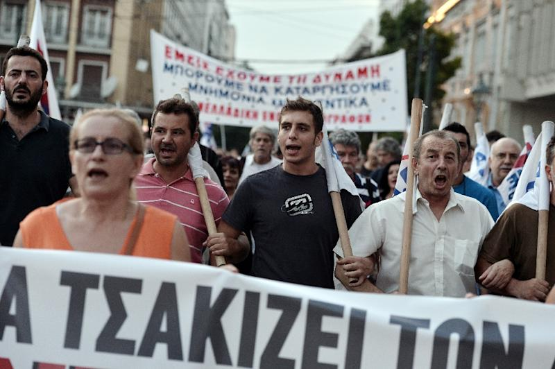 Protesters march in central Athens during a demonstration against the third bailout agreement on August 13, 2015 (AFP Photo/Louisa Gouliamaki)