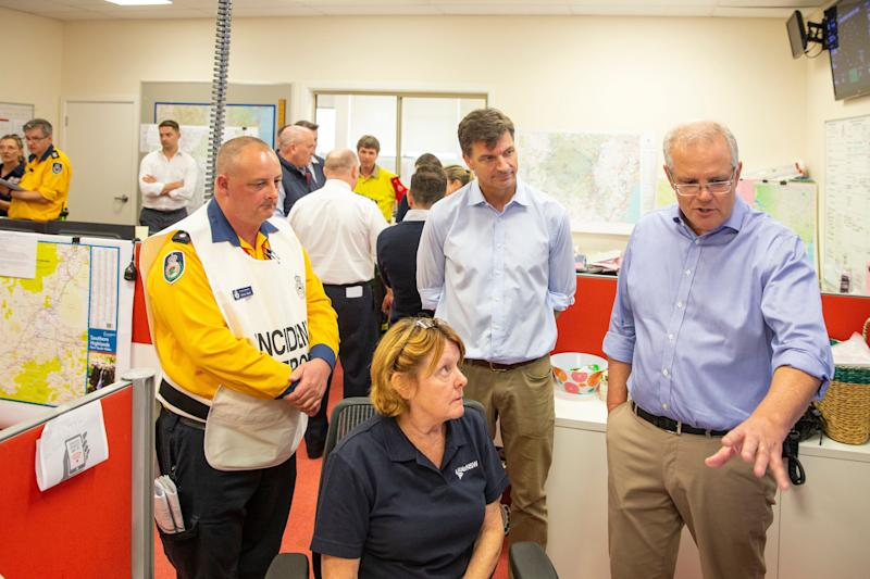 Prime Minister Scott Morrison talks to a volunteer at The Picton Evacuation Centre on December 22, 2019 in Picton, Australia. (Photo: Jenny Evans via Getty Images)