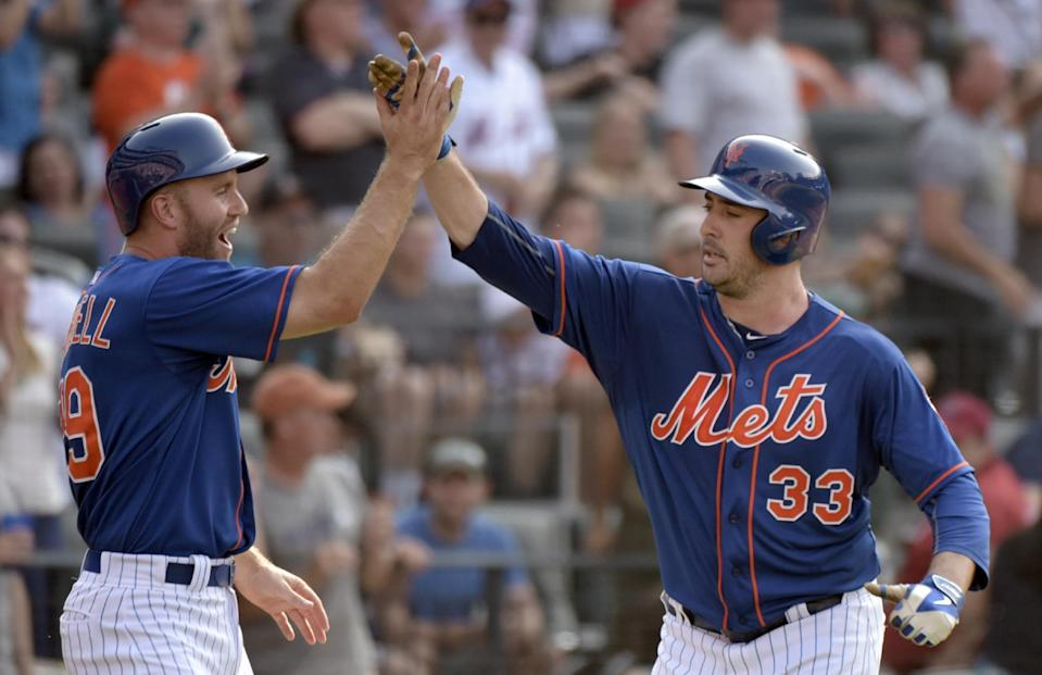 New York Mets' Matt Harvey, right, celebrates with teammate Eric Campbell after hitting a two-run home run scoring Campbell during the fifth inning of a baseball game against the Arizona Diamondbacks, Saturday, July 11, 2015, at Citi Field in New York. (AP Photo/Bill Kostroun)