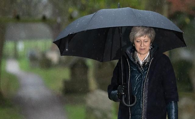 Britain's Prime Minister Theresa May likes to compares herself to her cricketing hero Geoffrey Boycott, who was a byword for doggedness as a batsman (AFP Photo/Daniel LEAL-OLIVAS)
