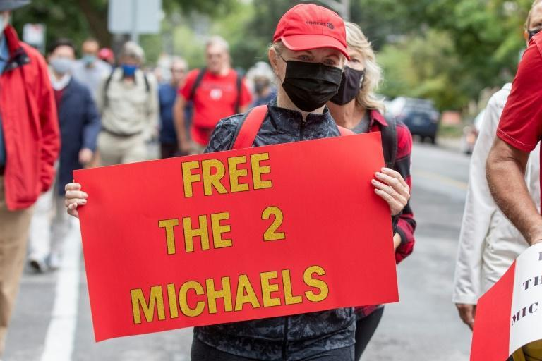 Supporters of Michael Kovrig and Michael Spavor take part in a 5-kilometer walk in Ottawa, Ontario on September 5, 2021, to mark the pair's 1,000 days in Chinese custody after they were charged with espionage (AFP/Lars Hagberg)