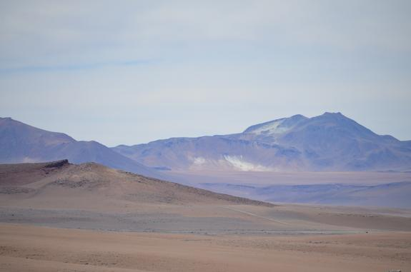 Chile's Atacama Desert is otherworldly, with red rocks and white salt coating the slopes of its mountains.
