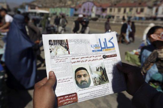 An Afghan man reads a local newspaper on May 25 with photos of the former leader of the Afghan Taliban, Mullah Akhtar Mansour, who was killed in a U.S. drone strike in Kabul, Afghanistan. (Photo: Rahmat Gul/AP)