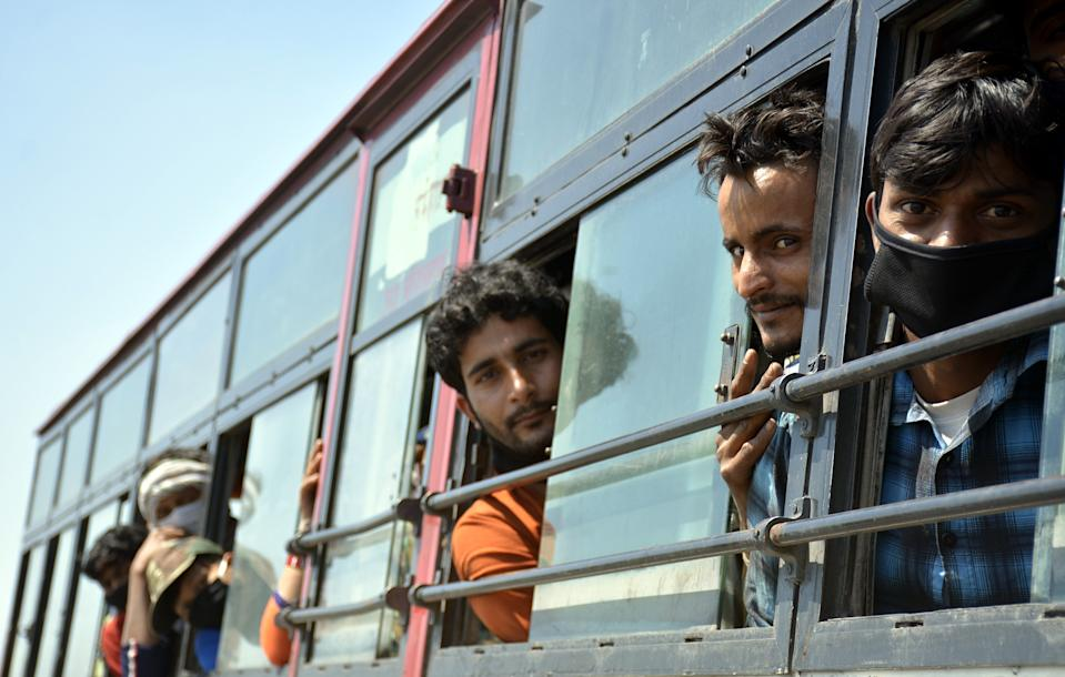 GHAZIABAD, INDIA - MARCH 28: Migrant workers seen inside a bus bound to their native state during Day 4 of the 21 day nationwide lockdown -- to check the spread of coronavirus, at Lal Kuan bus stand, on March 28, 2020 in Ghaziabad, India. (Photo by Sakib Ali/Hindustan Times via Getty Images)