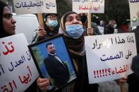 Families of some of the victims of the August 4 explosion at Beirut port, protest outside the Justice Palace in Beirut