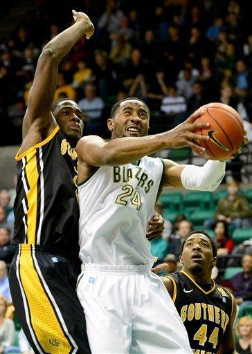 UAB's Preston Purifoy shoots in front of Southern Mississippi's Norville Carey in the first half of an NCAA college basketball game at Bartow Arena in Birmingham, Ala., Saturday, Feb. 2, 2013. (AP Photo/ AL.com, Mark Almond)