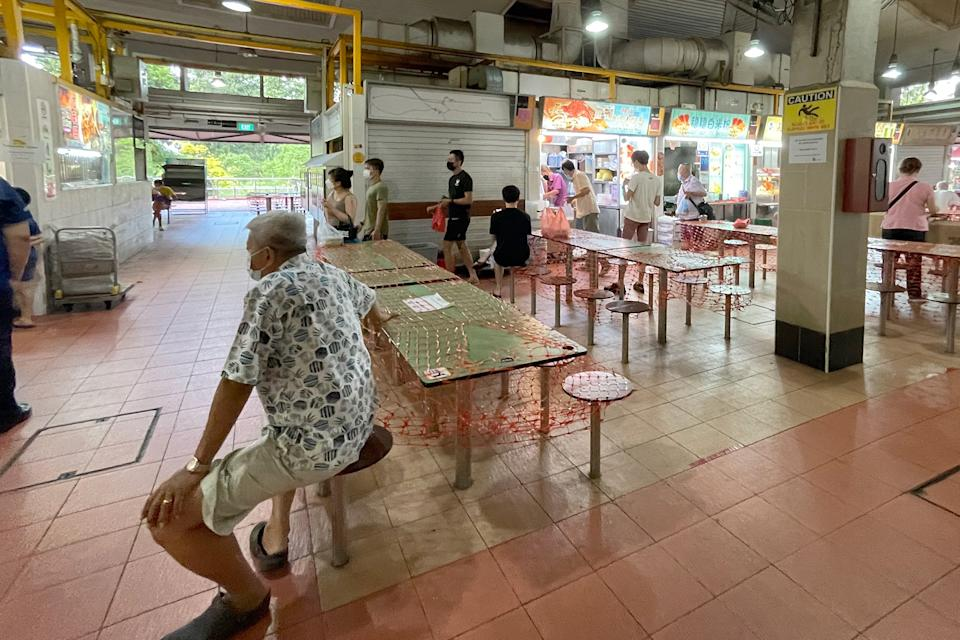 People seen at the Changi Village Hawker Centre on 27 May 2021, amid Singapore's Phase 2 (Heightened Alert) period. (PHOTO: Dhany Osman / Yahoo News Singapore)
