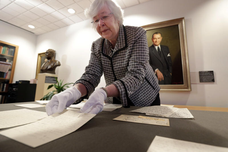 "Archivist Claudia Anderson handles some of the love letters exchanged between Lyndon Johnson, then a 26-year-old congressional aide, and Claudia Alta ""Lady Bird"" Taylor, then 21, at the LBJ Presidential Library at the University of Texas, Wednesday, Feb. 13, 2013, in Austin, Texas. For the first time, the entire collection of nearly 100 love letters written between Lyndon Johnson and Lady Bird Johnson during their 21/2-month courtship in 1934 is being made available to the public, beginning on Valentine's Day. (AP Photo/Eric Gay)"