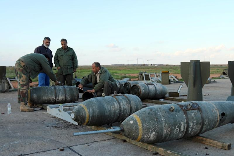 Soldiers loyal to Libya's internationally recognised government inspect munitions at the Benina air base on the outskirts of Benghazi, on December 10, 2015 (AFP Photo/Abdullah Doma)