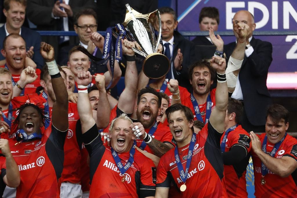 Saracens players celebrate their win with the trophy after the rugby union European Champions Cup Final match between Saracens and Clermont Auvergne at Murrayfield Stadium in Edinburgh, Scotland on May 13, 2017 (AFP Photo/Odd ANDERSEN)