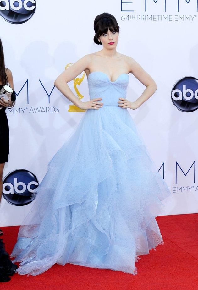 """New Girl"" star Zooey Deschanel is known for her quirky sense of style, but her strapless blue Reem Acra gown was a little too precious for words – and featured way too much tulle. If the 32-year-old actress was trying to look like a Disney princess, then she succeeded!"