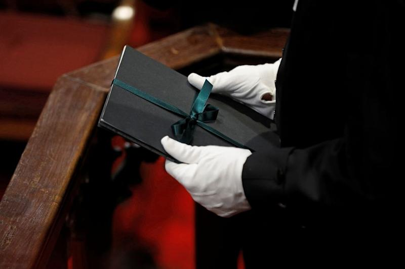 Speaker of the House of Commons Liberal Ontario MP Anthony Rota holds a copy of the throne speech in the Senate in Ottawa on Dec. 5, 2019.