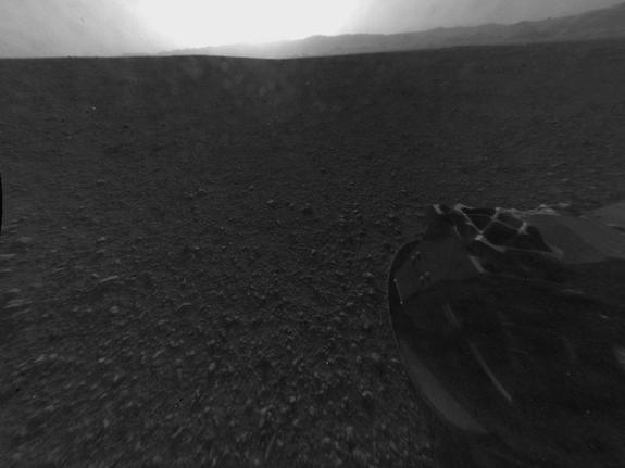 """This full-resolution version of one of the first images taken by a rear-left Hazard-Avoidance camera on NASA's Curiosity rover, was released on Aug. 6, 2012.The image was originally taken through the """"fisheye"""" wide-angle lens, but has been """"lin"""