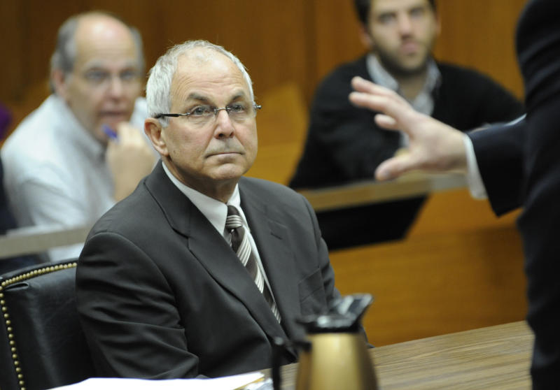 FILE - In this April 3, 2009 file photo, Peter Madoff, brother of Bernard Madoff, attends his court hearing before judge Stephen Bucaria at Mineola State Supreme Court, in Mineola, N.Y.  Madoff will plead guilty on Friday, June 29, 2012, to conspiracy and falsifying records, admitting his role in the multibillion-dollar fraud that destroyed the savings of thousands of investors, prosecutors told a judge on Wednesday, June 27, 2012. (AP Photo/Louis Lanzano, Pool, File)