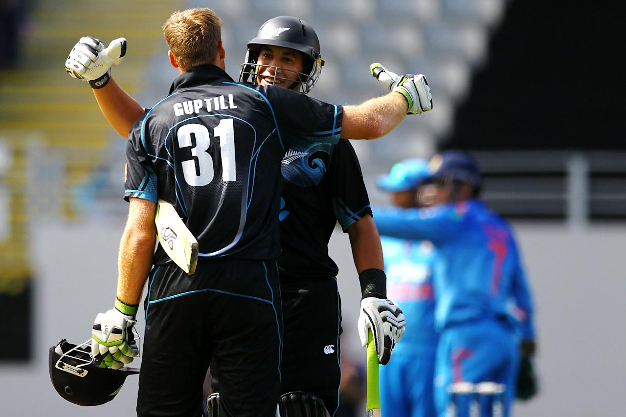 AUCKLAND, NEW ZEALAND - JANUARY 25:  Martin Guptill of New Zealand celebrates his century with teammate Ross Taylor during the One Day International match between New Zealand and India at Eden Park on January 25, 2014 in Auckland, New Zealand.  (Photo by Anthony Au-Yeung/Getty Images)