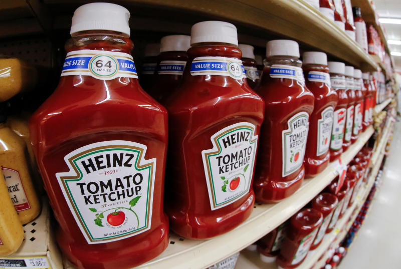 FILE- This Feb. 21, 2018, file photo shows a display of Heinz Ketchup in a market in Pittsburgh. Kraft Heinz is restating financial results for 2016, 2017 and the first nine months of 2018. The company has been conducting an internal investigation after the SEC launched a probe into its procurement operations. Kraft Heinz says its investigation is 'substantially complete.' (AP Photo/Gene J. Puskar, File)