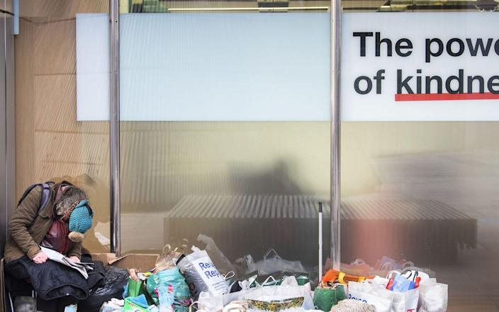 File photo dated 25/1/2021 of a homeless person sits in a window in the City of London. The number of rough sleepers known to be living on London's streets has risen by almost a quarter in three months, figures show. Issue date: Friday January 29, 2021. PA Photo. There were 412 rough sleepers deemed to be permanently on the streets between October to December 2020, according to data published by the Greater London Authority. - Victoria Jones/PA Wire