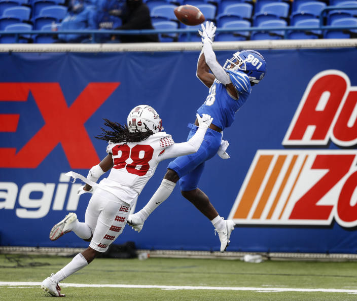 Memphis receiver Tahj Washington, right, hauls in a touchdown catch against Temple defender Aaron Adu, left, during an NCAA college football game Saturday, Oct. 24, 2020, in Memphis, Tenn. (Mark Weber/Daily Memphian via AP)