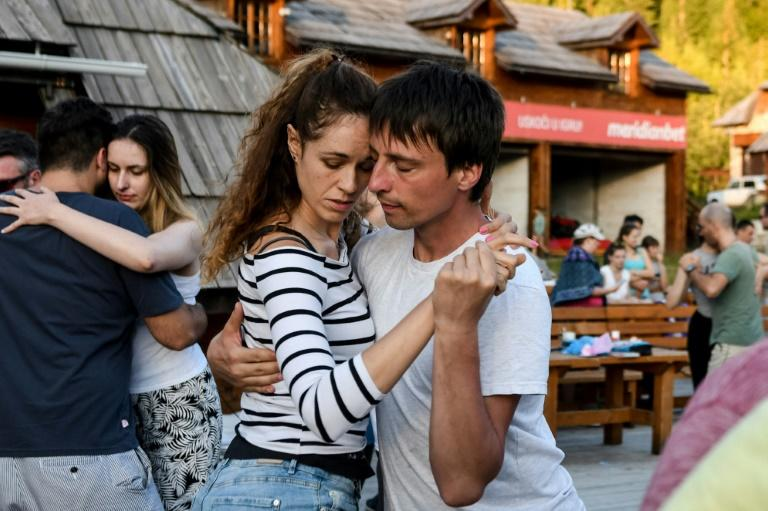 Darko Dozic (R) dances tango with a partner during Tango Camp this summer in Kolasin where many locals have embraced the sensual Latin dance