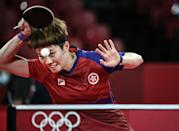 <p>Hong Kong's Doo Hoi-kem competes against China's Chen Meng during their women's singles quarterfinals table tennis match at the Tokyo Metropolitan Gymnasium during the Tokyo 2020 Olympic Games in Tokyo on July 28, 2021. (Photo by Anne-Christine POUJOULAT / AFP)</p>