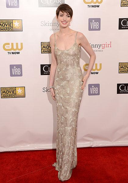 "Anne Hathaway: We're a bit disappointed with the Oscar de la Renta gown the ""Les Miserables"" (and Oscar Best Supporting Actress nominee) wore. Where's the drama? Hathaway tones it down a lot in the slinky, nude-coloured dress. We hope she livens it up come Golden Globe and Oscar night. (Photo by Jason Merritt/Getty Images)"