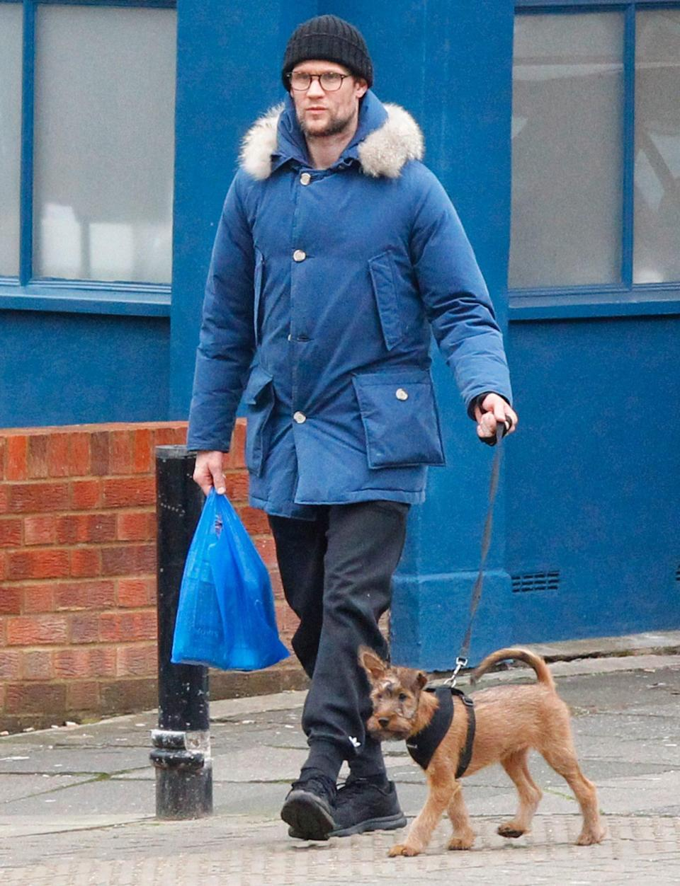 <p>A bundled up Matt Smith takes his dog for a walk in London on Tuesday.</p>