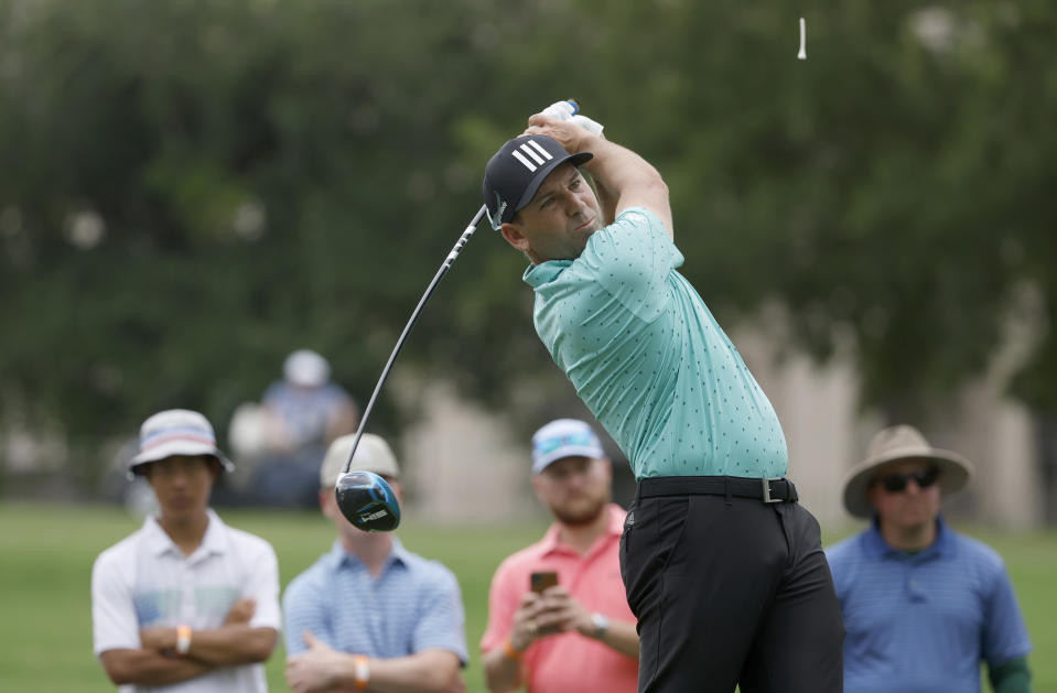 Sergio Garcia plays his shot from the 18th tee during the first round of the Charles Schwab Challenge golf tournament at the Colonial Country Club in Fort Worth, Texas, Thursday, May 27, 2021. (AP Photo/Ron Jenkins)