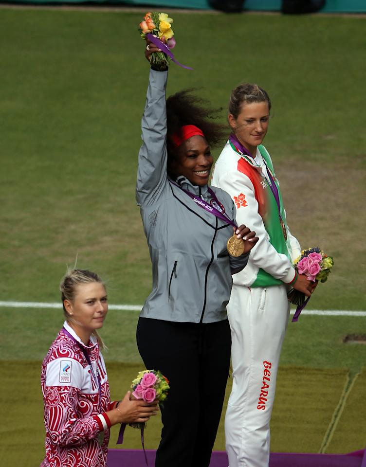 LONDON, ENGLAND - AUGUST 04:  (L-R) Silver medalist Maria Sharapova of Russia, gold medalist Serena Williams of the United States and bronze medalist Victoria Azarenka of Belarus pose on the podium during the medal ceremony the Women's Singles Tennis on Day 8 of the London 2012 Olympic Games at the All England Lawn Tennis and Croquet Club on August 4, 2012 in London, England.  (Photo by Elsa/Getty Images)