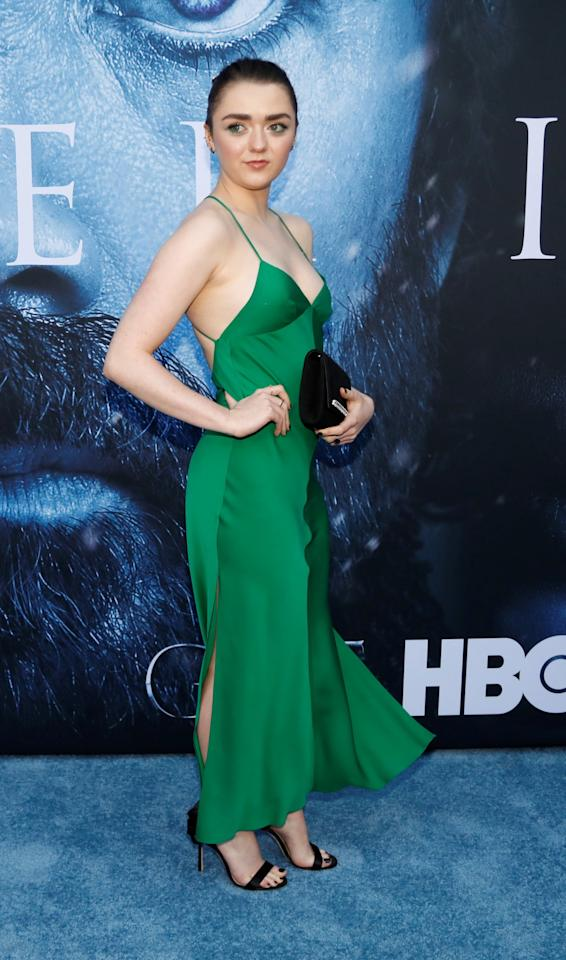 <p>Everyone's favourite badass wore an emerald green slip dress by Milly.<br /><i>[Photo: Reuters]</i> </p>
