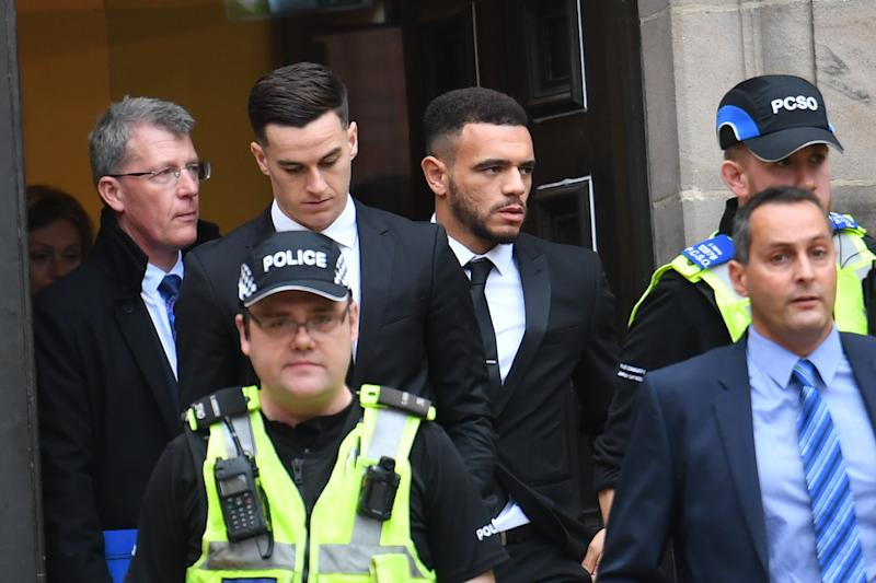 Police escort Derby County footballers Tom Lawrence (centre left) and Mason Bennett (centre right) from Derby Magistrates' Court, where they have avoided prison after they admitted drink-driving over a crash which left their club captain seriously injured.