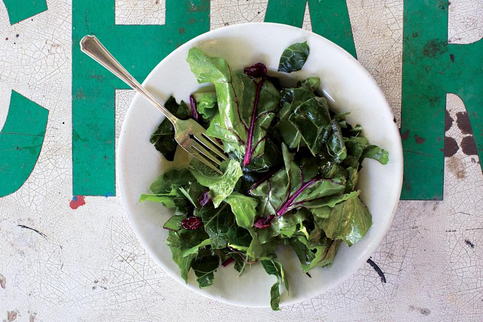 """Be on the lookout for collards with smaller, tender leaves. If using more mature bunches, cut into thin ribbons instead of tearing. <a href=""""https://www.epicurious.com/recipes/food/views/hardy-greens-with-lemon-garlic-vinaigrette-56390130?mbid=synd_yahoo_rss"""" rel=""""nofollow noopener"""" target=""""_blank"""" data-ylk=""""slk:See recipe."""" class=""""link rapid-noclick-resp"""">See recipe.</a>"""