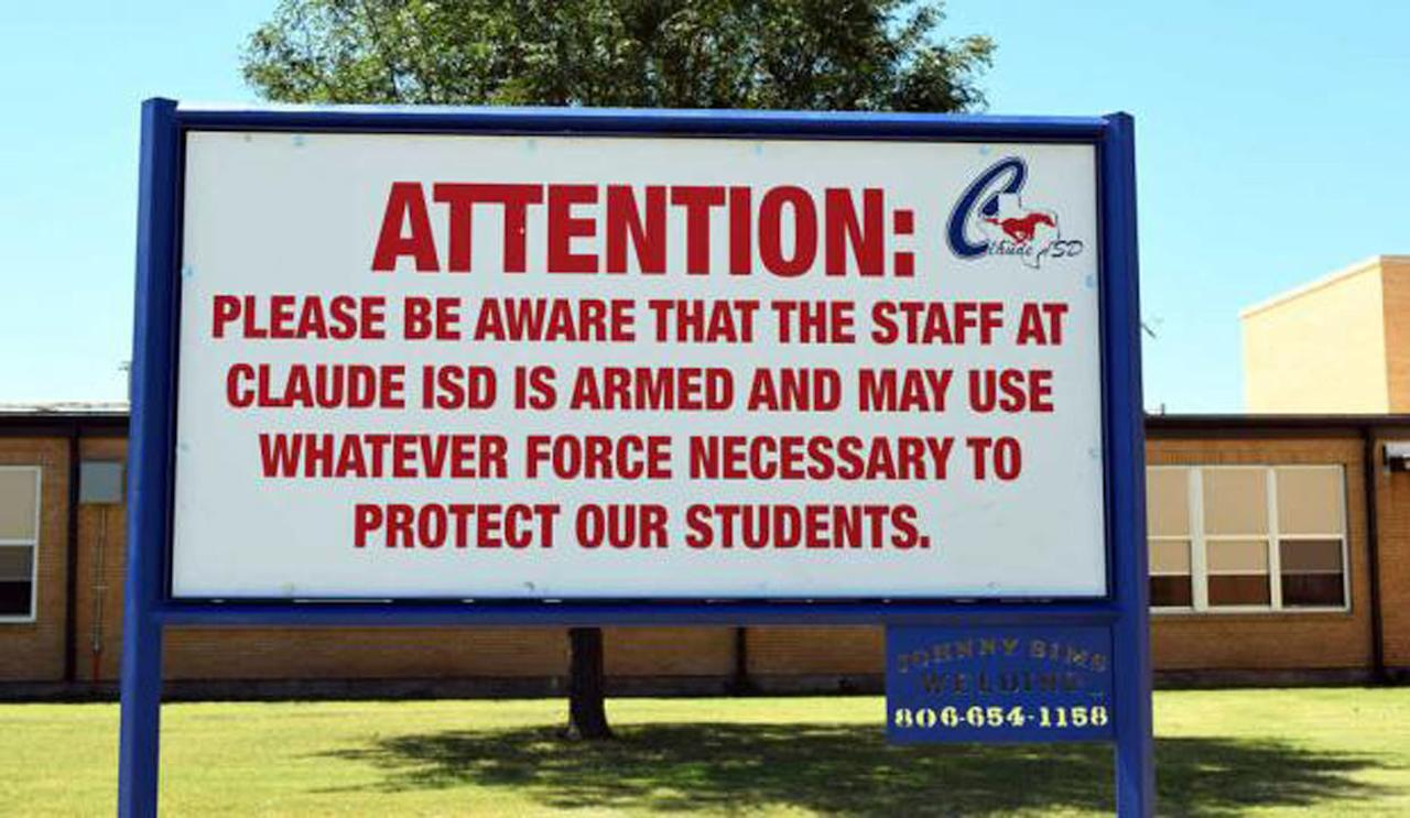 "This August 2016 photo shows a sign outside a school in Claude, Texas, which Claude ISD posts outside their schools. In the aftermath of yet another mass school shooting, President Donald Trump says that if one of the victims, a football coach, had been armed ""he would have shot and that would have been the end of it."" Revisiting an idea he raised in his campaign, Trump's comments in favor of allowing teachers to be armed come as lawmakers in several states are wrestling with the idea, including in Florida, where the 17 most recent school shooting victims are being mourned.(Creede Newton/Amarillo Globe-News via AP)"