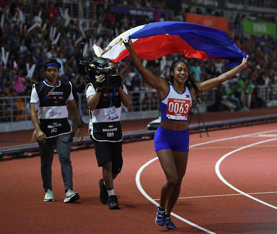 Kristina Marie Knott from the Philippines celebrates after winning in the women's 200m athletics event at the SEA Games (Southeast Asian Games) at the athletics stadium in Clark, Capas, Tarlac province north of Manila on December 7, 2019. (Photo by TED ALJIBE / AFP) (Photo by TED ALJIBE/AFP via Getty Images)