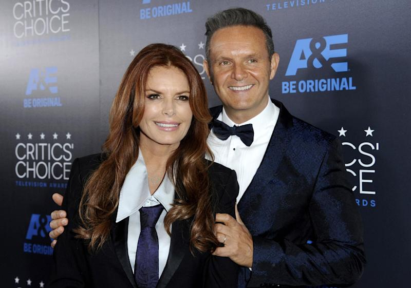 FILE - In this May 31, 2015 file photo, Roma Downey, left, and Mark Burnett arrive at the Critics' Choice Television Awards in Beverly Hills, Calif. Burnett and Downey are launching a faith-and-family entertainment broadcast network next month. Light TV will air on Fox stations and affiliates and capitalize on MGM's film and TV library.  (Photo by Richard Shotwell/Invision/AP, File)