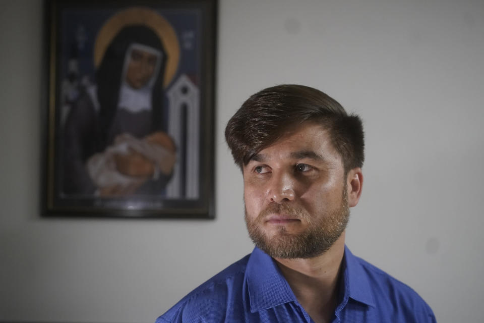 Azim Kakaie, 34, speaks during an interview Thursday, Sept. 2, 2021, in Salt Lake City. The first Afghan refugee to arrive in Utah since the nation's swift takeover by the Taliban is a man who built a life as an air-traffic controller in Kabul before he had to flee the country. Kakaie said that his wife tried to leave the country for days and endured beatings at Taliban checkpoints before she was able to board a plane. She's now in Germany. (AP Photo/Rick Bowmer)