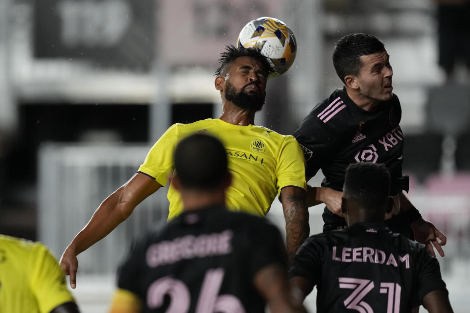 Nashville midfielder Anibal Godoy heads the ball past Inter Miami midfielder Jay Chapman, during the first half of an MLS soccer match, Wednesday, Sept. 22, 2021, in Fort Lauderdale, Fla. (AP Photo/Rebecca Blackwell)